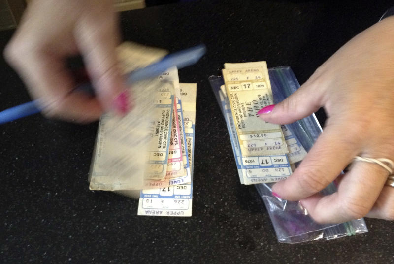 Cheryl Cohen handles tickets from a canceled 1979 concert by The Who, which were exchanged by fans for their upcoming Quadrophenia tour concert in February 2013, at the Dunkin Donuts Center in Providence, R.I., Tuesday, July 31, 2012. The 1979 concert was cancelled due to safety concerns after 11 people died in a stampede before a show in Ohio. The arena honored the tickets for that canceled show, which will be auctioned off to help the Special Olympics. (AP Photo/Michelle R. Smith)