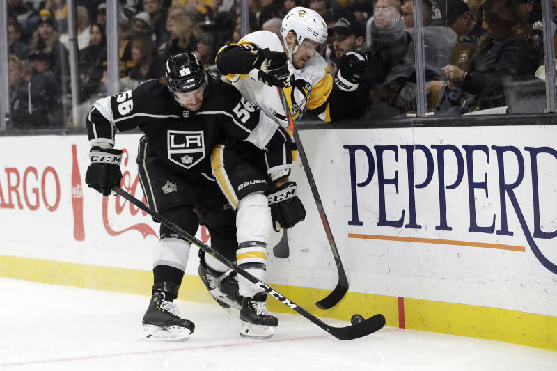 Los Angeles Kings' Kurtis MacDermid (56) collides with Pittsburgh Penguins' Brandon Tanev during the first period of an NHL hockey game Wednesday, Feb. 26, 2020, in Los Angeles. (AP Photo/Marcio Jose Sanchez)