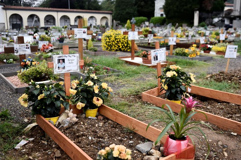 FILE PHOTO: Graves of people who had recently died due to COVID-19 are seen at the cemetery of Nembro, near Bergamo
