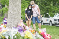 <p>Mourners take a moment to reflect at the scene of a hate motivated vehicle attack in London, Ont. on Tuesday, June 8, 2021, which left four members of a family dead and sent one to hospital on Sunday evening. THE CANADIAN PRESS/ Geoff Robins</p>