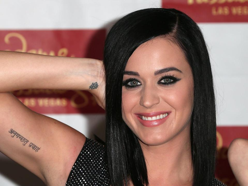 """<p>During their short-lived marriage, <a class=""""link rapid-noclick-resp"""" href=""""https://www.popsugar.co.uk/Katy-Perry"""" rel=""""nofollow noopener"""" target=""""_blank"""" data-ylk=""""slk:Katy Perry"""">Katy Perry</a> and <a class=""""link rapid-noclick-resp"""" href=""""https://www.popsugar.co.uk/Russell-Brand"""" rel=""""nofollow noopener"""" target=""""_blank"""" data-ylk=""""slk:Russell Brand"""">Russell Brand</a> each got matching Sanskrit tattoos that translate to """"go with the flow."""" The good news is that the tattoo still works even after their split.</p>"""