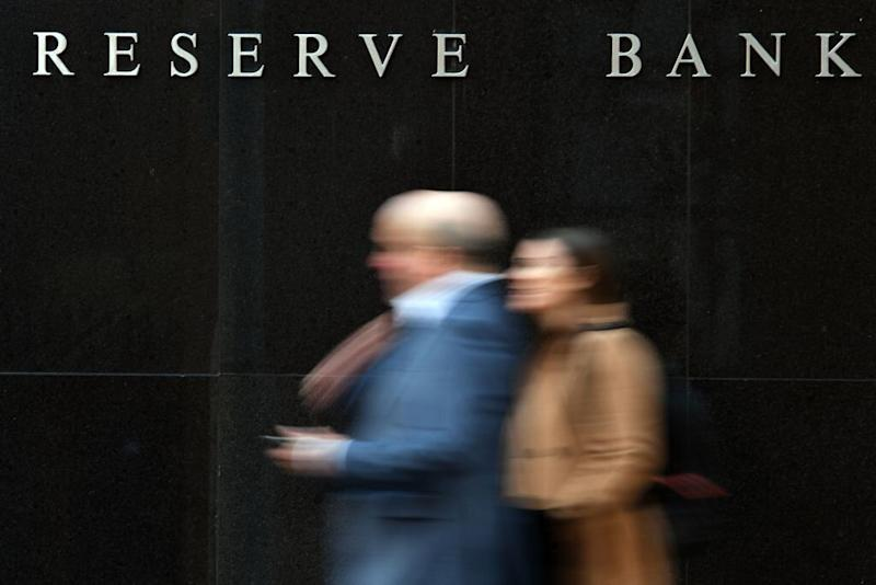 People walk past the Reserve Bank of Australia building in Sydney on May 7, 2019. Source: Getty
