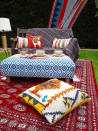 """<p>You can easily create a cool Bohemian vibe by bringing a few cushions and rugs outside. <a href=""""https://www.seasonsincolour.com/single-post/My-5-step-New-Bohemian-Garden"""" rel=""""nofollow noopener"""" target=""""_blank"""" data-ylk=""""slk:[Photo: Seasonsincolour]"""" class=""""link rapid-noclick-resp"""">[Photo: Seasonsincolour]</a> </p>"""