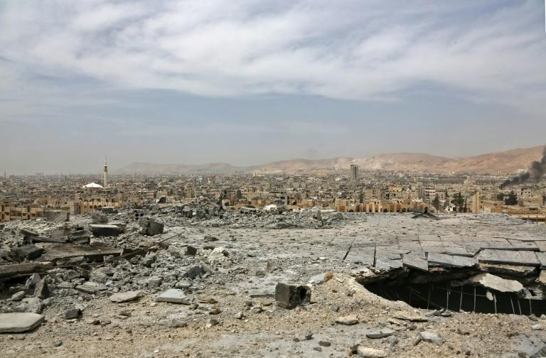 Syria agreed to hand over its chemical arsenal in 2013, avoiding US and French air strikes in retaliation for a suspected sarin attack that killed 1,400 people in the Damascus suburb of Ghouta (AFP Photo/STRINGER)