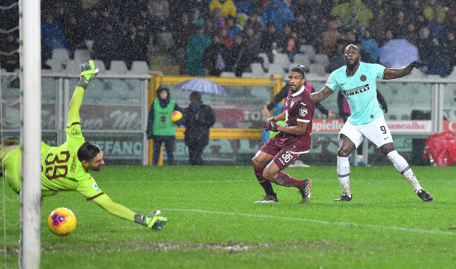 Inter's Romelu Lukaku, right, scores a goal during the Italian Serie A soccer match between Torino FC and Inter Milan at the Olimpico Grande Torino stadium in Turin, Italy, Saturday, Nov. 23, 2019. (Di Marco/ANSA via AP)