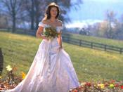 <p>Maggie's dress in <em>Runaway Bride </em>was just big and pretty enough to distract wedding goers from noticing that she's probably wearing sneakers underneath that skirt. Hey, when a girl's gotta dash, a girl's gotta dash.</p>