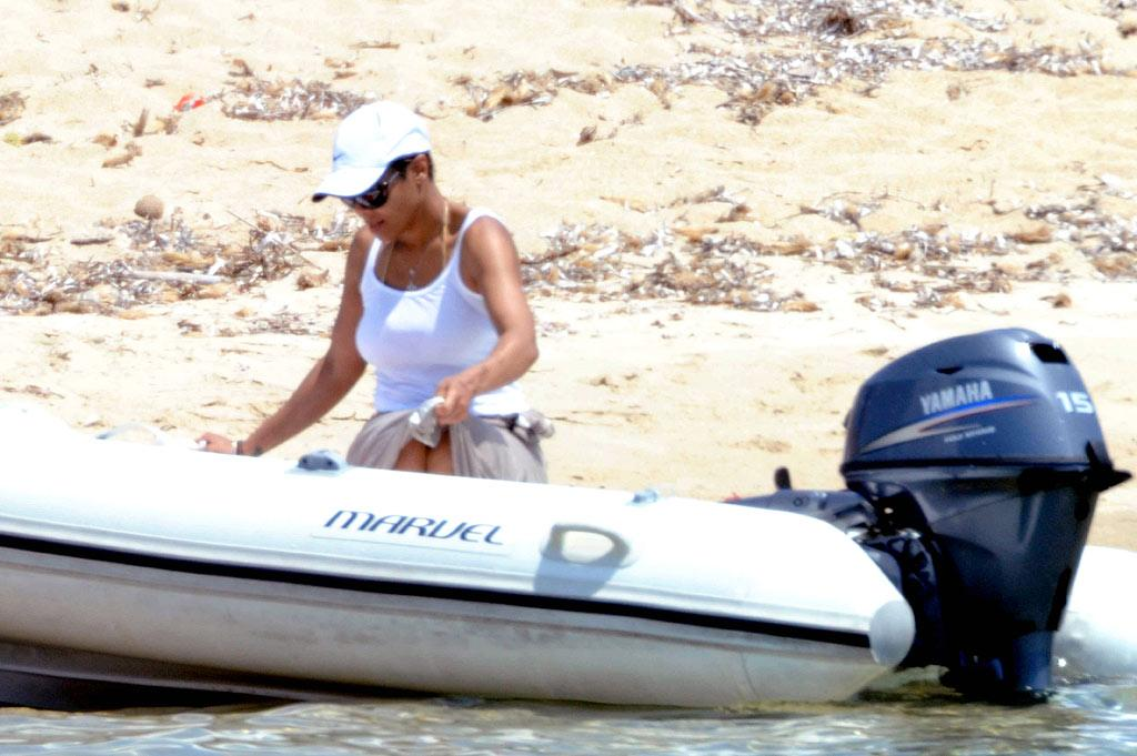 """Meanwhile, singer Janet Jackson selected a more low-key mode of transportation when she and her reported boyfriend, Wissam Al Mana, caught some R&R in Sardinia, Italy. Ciao Pix/<a href=""""http://www.infdaily.com"""" target=""""new"""">INFDaily.com</a> - July 20, 2010"""