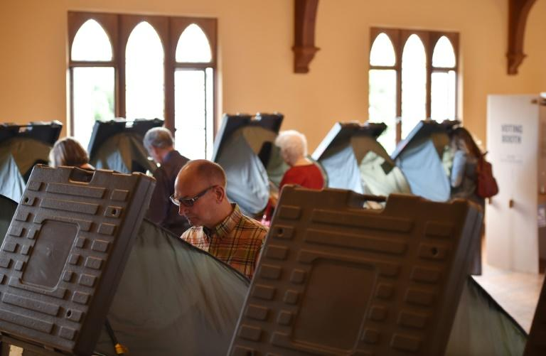 """A 2018 study recommended that electronic voting machines use """"human-readable"""" ballots which can be audited (AFP Photo/Robyn Beck)"""