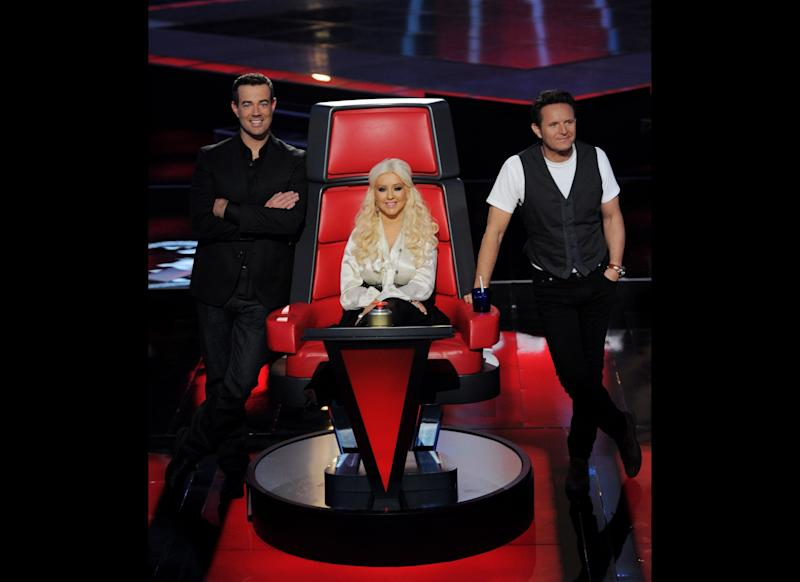 Host Carson Daly, singer Christina Aguilera and executive producer Mark Burnett appear at a press junket for NBC's 'The Voice' at Sony Studios on October 28, 2011 in Culver City, California. (Getty)