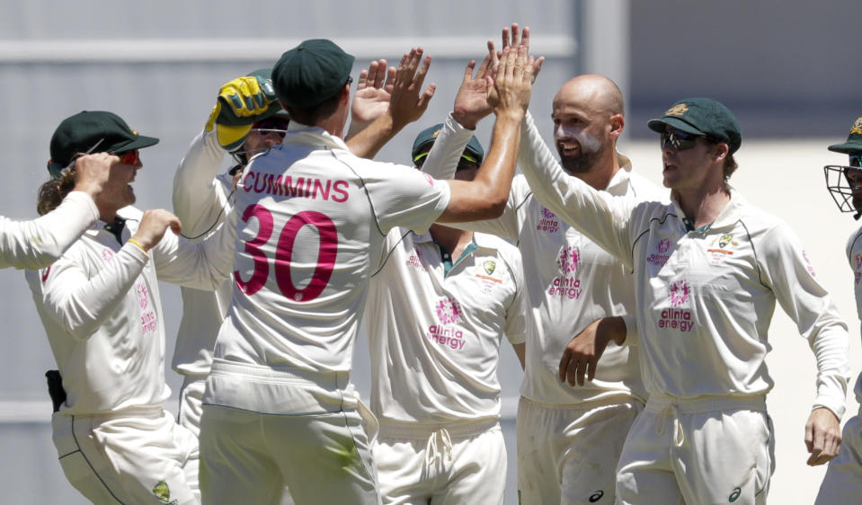 Australian players celebrate the dismissal of India's Rishabh Pant during play on the final day of the third cricket test between India and Australia at the Sydney Cricket Ground, Sydney, Australia, Monday, Jan. 11, 2021. (AP Photo/Rick Rycroft)