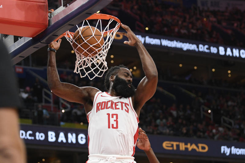 Houston Rockets guard James Harden (13) dunks against the Washington Wizards during the first half of an NBA basketball game, Wednesday, Oct. 30, 2019, in Washington. (AP Photo/Nick Wass)