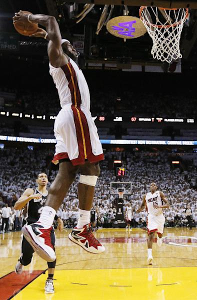 Miami Heat small forward LeBron James (6) dunks the ball against the San Antonio Spurs during the second half of Game 2 in the NBA Finals basketball game, Sunday June 9, 2013, in Miami. (AP Photo/Christian Petersen, Pool)