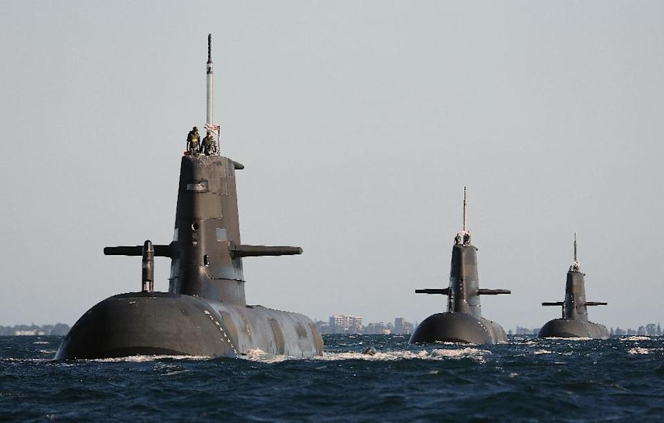 Australian Collins class submarines in formation in Cockburn Sound, near Rockingham in Western Australia on March 22, 2015 (AFP Photo/CPOIS David Connolly)