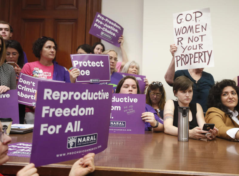 """Supporters crowd a meeting room before a roundtable discussion at the Georgia State Capitol in Atlanta on Thursday, May 16, 2019 to discuss abortion bans in Georgia and across the country. Georgia was the fourth state this year to pass anti-abortion """"heartbeat"""" legislation, but Democratic presidential candidates have taken aim at the state's law banning most abortions after six weeks that's set to go into effect in January. (Bob Andres/Atlanta Journal-Constitution via AP)"""