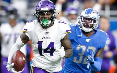 Minnesota Vikings wide receiver Stefon Diggs (14) runs after a catch against Detroit Lions defensive back Tavon Wilson (32) during the fourth quarter at Ford Field - Credit: USA Today