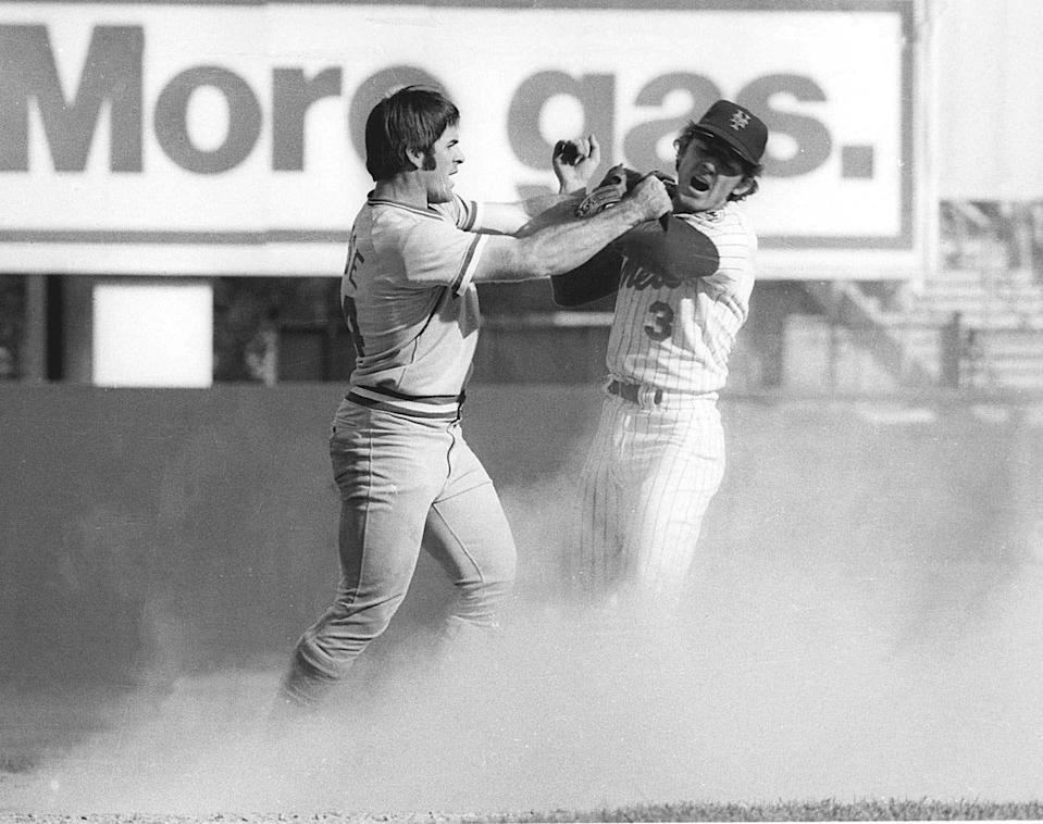 Pete Rose swings at New York Mets shortstop Bud Harrelson after Rose failed to break up a double play in Game 3 of the 1973 National League Championship Series.