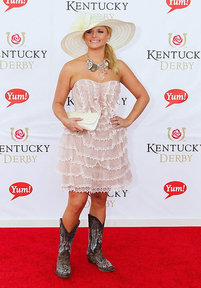 "Country crooner Miranda Lambert was a walking fashion faux pas in her frilly pink dress, over-the-top hat and necklace, and ... her brown cowboy boots?! Michael Hickey/<a href=""http://www.wireimage.com"" target=""new"">WireImage.com</a> - May 7, 2011"