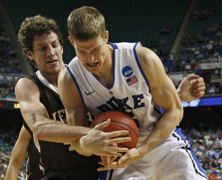 Duke's Mason Plumlee, right, and Lehigh's Gabe Knutson, left, battle for a rebound during the first half of an NCAA tournament second-round college basketball game in Greensboro, N.C., Friday, March 16, 2012. (AP Photo/Gerry Broome)