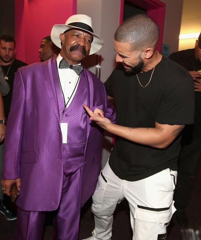 Everyone — not just Drake — should stop and point at Dennis Graham, wearer of purple suits and shoes. He's got it going on. (Photo: Chris Polk/BBMA2017/Getty Images for DCP)