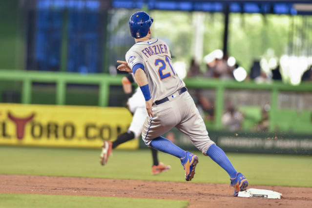 New York Mets' Todd Frazier rounds second base on his way to scoring during the second inning of a baseball game against the Miami Marlins in Miami, Sunday, July 1, 2018. (AP Photo/Gaston De Cardenas)