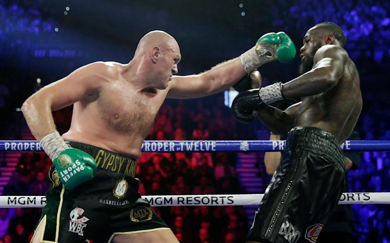 In this Feb. 22, 2020, file photo, Tyson Fury, left, of England, fights Deontay Wilder during a WBC heavyweight championship boxing match in Las Vegas. - AP
