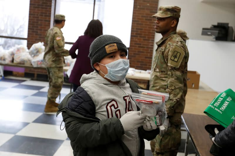 10-year-old Selvin Jimenez receives Food donations From the National Guard in New Rochelle