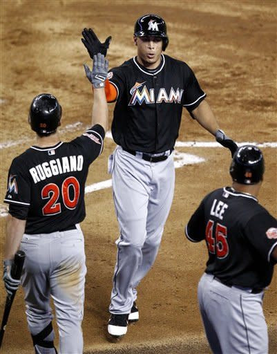 Stanton homers twice as Marlins rout D-backs 12-3