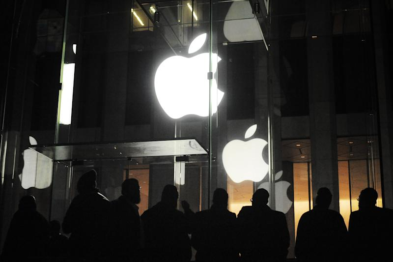 People gather outside an Apple retail store on Fifth Avenue in the Manhattan borough of New York, Friday, March 16, 2012, as they wait for the 8 a.m. local time release of the new iPad tablet. (AP Photo/Jeffrey Furticella)