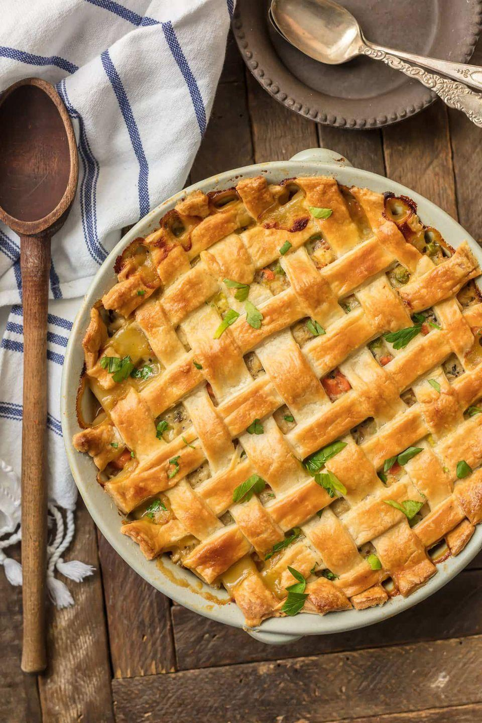 """<p>This creamy comfort food takes all the hassle out of the usual pie-making procedure: Simply fill a <a href=""""https://www.amazon.com/Rachael-Ray-Stoneware-13-Inch-Rectangular/dp/B00MQMEX1W?tag=syn-yahoo-20&ascsubtag=%5Bartid%7C10050.g.3726%5Bsrc%7Cyahoo-us"""" rel=""""nofollow noopener"""" target=""""_blank"""" data-ylk=""""slk:casserole dish"""" class=""""link rapid-noclick-resp"""">casserole dish</a> with all the ingredients, top with a store bought crust, and bake. </p><p><strong>Get the recipe at <a href=""""https://www.thecookierookie.com/chicken-pot-pie-casserole/"""" rel=""""nofollow noopener"""" target=""""_blank"""" data-ylk=""""slk:The Cookie Rookie"""" class=""""link rapid-noclick-resp"""">The Cookie Rookie</a>.</strong></p>"""
