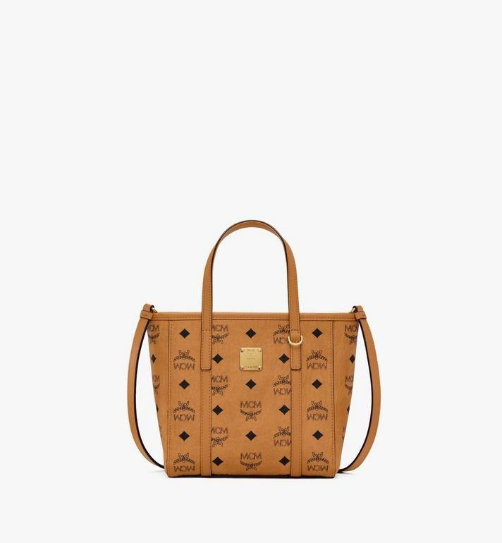 "<p><strong>MCM</strong></p><p>mcmworldwide.com</p><p><strong>$520.00</strong></p><p><a href=""https://go.redirectingat.com?id=74968X1596630&url=https%3A%2F%2Fus.mcmworldwide.com%2Fen_US%2Fwomen%2Fbags%2Fall-bags%2Ftoni-shopper-in-visetos%2FMWPAATN04CO001.html%3Fcgid%3Dwomen-all-bags&sref=https%3A%2F%2Fwww.cosmopolitan.com%2Fstyle-beauty%2Ffashion%2Fg33446124%2Fbest-splurges-hauliday%2F"" rel=""nofollow noopener"" target=""_blank"" data-ylk=""slk:Shop Now"" class=""link rapid-noclick-resp"">Shop Now</a></p><p>Okay, we know you have a ton of tote bags, but how about this one in a mini size? So cute! </p><p><strong>Promotion</strong>: With the code <strong>MCMGIFT</strong>, spend $500 and receive a free gift with purchase. </p>"