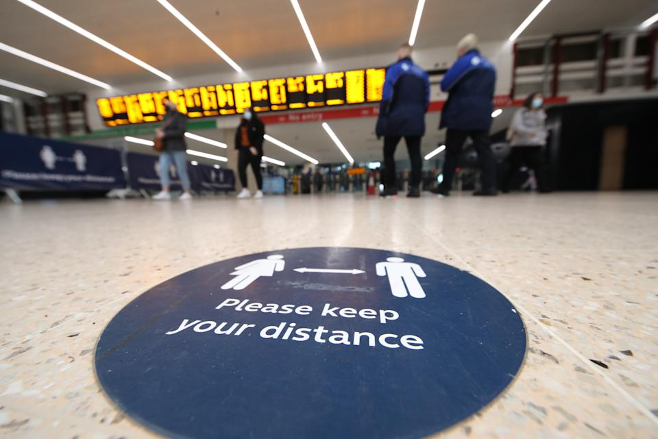 Social distance sign at Leeds train station at the start of a four week national lockdown for England. (Photo by Danny Lawson/PA Images via Getty Images)
