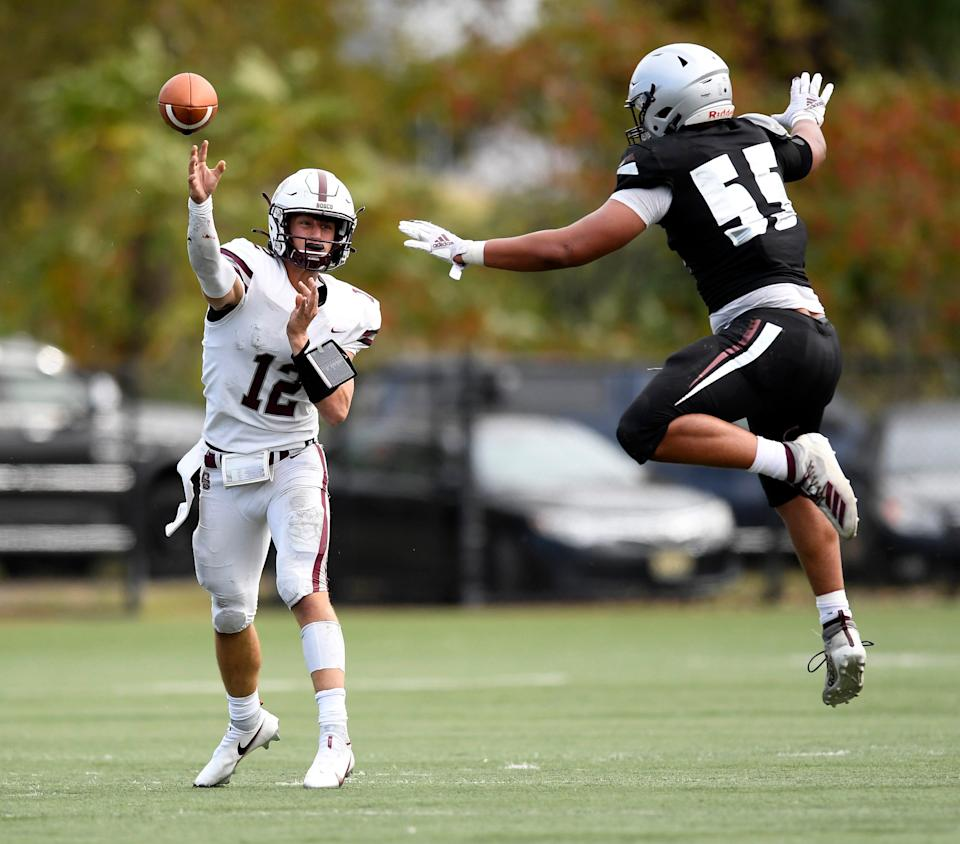 Don Bosco quarterback Jake Robbins throws with pressure from St. Peter's defender George Rooks.  No. 1 St.  Peter Prep defeats Don Bosco Prep, 21-7, in Jersey City on Saturday, October 10, 2020.