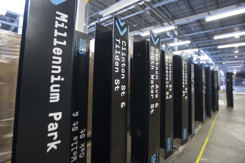 In this Tuesday, June 11, 2013 photo, street signs that will mark each Divvy kiosk wait to be assembled at the Divvy roll-out facility in Chicago. Chicago's new bike-share program, Divvy, will start in two weeks with about 750 bikes at 75 solar-powered docking stations and expand over the next year to at least 4,000 bikes at 400 stations scattered across the city. Users can get a $75 annual membership or a $7 day pass. (AP Photo/Scott Eisen)