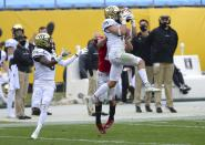 Wake Forest defensive back Nick Andersen intercepts a Wisconsin pass during the second quarter of the Duke's Mayo Bowl NCAA college football game at Bank of America Stadium in Charlotte, N.C., Wednesday, Dec. 30, 2020. (Jeff Siner/The News & Observer via AP)
