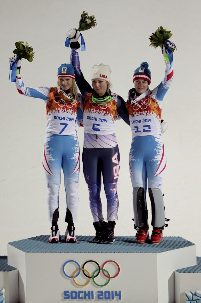 Women's gold medalist, United States' Mikaela Shiffrin, center, silver medalist Austria's Marlies Schild, left, and bronze medalist Kathrin Zettel photo for photographers during the flower ceremony for the women's slalom at the Sochi 2014 Winter Olympics, Friday, Feb. 21, 2014, in Krasnaya Polyana, Russia. (AP Photo/Charlie Riedel)