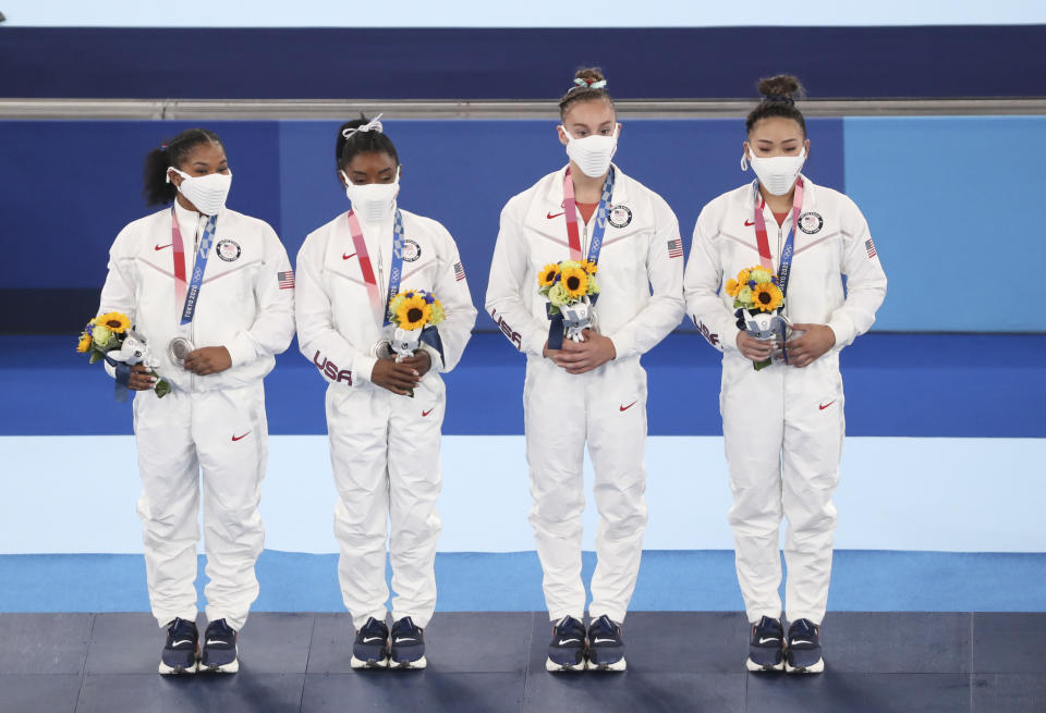 Pictured here, Team USA with their silver medals in the artistic Women's Team Final.