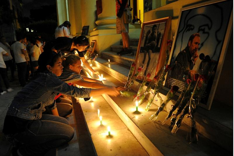Students light candles in honour of Cuban revolutionary leader Fidel Castro at the Havana University in Havana on November 26, 2016, a day after his death