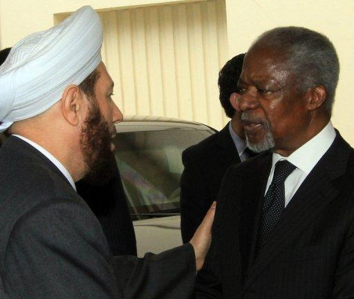 Syrian Grand Mufti Ahmed Hassun (L) greets UN-Arab League envoy for Syria Kofi Annan in Damascus. Annan left Damascus on Sunday without managing to secure an accord to end bloodletting in Syria, as fighting raged in major flashpoints leaving dozens more dead