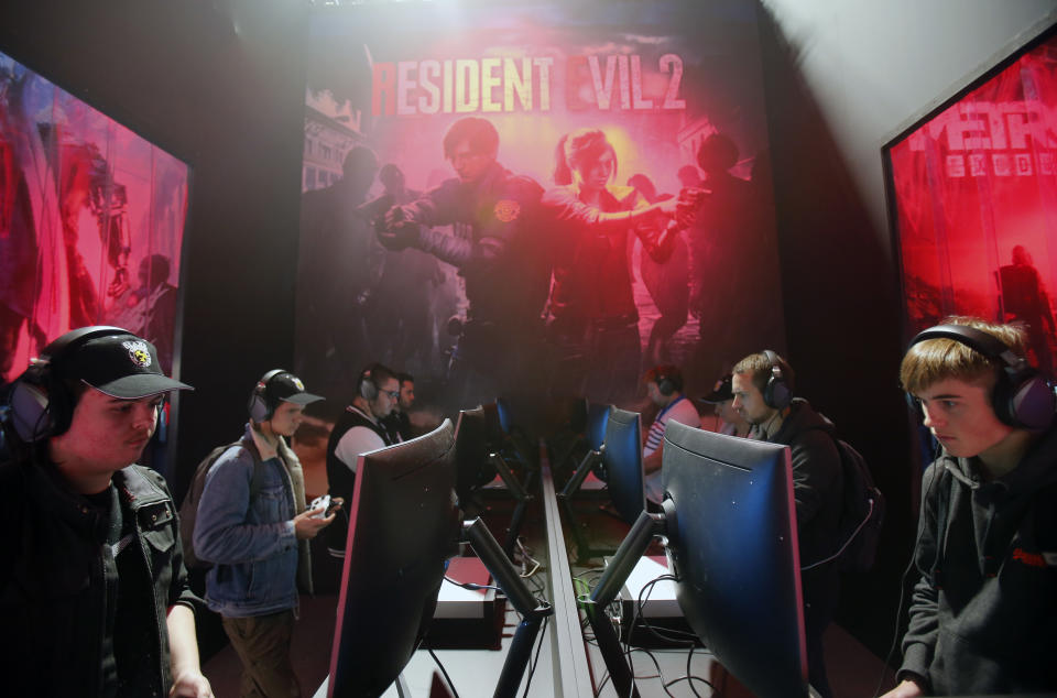 Gamers play the video game 'Resident Evil 2 Remake' developed by and published by Capcom during the 'Paris Games Week' on October 27, 2018. (Photo by Chesnot/Getty Images)