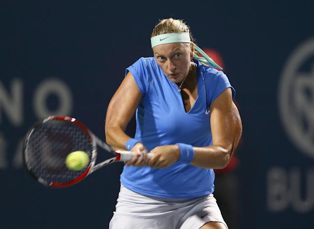 TORONTO, ON - AUGUST 07: Petra Kvitova of the Czech Republic hits a return during her match against Eugenie Bouchard of Canada on day three of the Rogers Cup Toronto at Rexall Centre at York University on August 7, 2013 in Toronto, Ontario, Canada. (Photo by Andy Lyons/Getty Images)