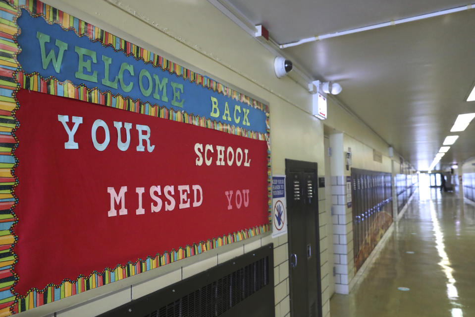 A Welcome Back sign on a bulletin board Thursday, Feb. 11, 2021, greets returning students at Chicago's William H. Brown Elementary School. In-person learning for students in pre-k and cluster programs began Thursday, since the district's agreement with the Chicago Teachers Union was reached. (AP Photo/Shafkat Anowar, Pool)