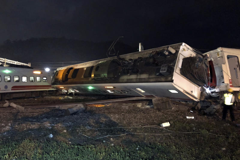 CORRECTS PLACE - In this photo released by Taiwan Railways Administration, train carriages are scattered at the site of a train derailment in Yilan county northeastern Taiwan on Sunday, Oct. 21, 2018. The Puyuma express train was carrying more than 300 passengers toward Taitung, a city on Taiwan's southeast coast, when it went off the tracks on Sunday afternoon. (Taiwan Railways Administration via AP)