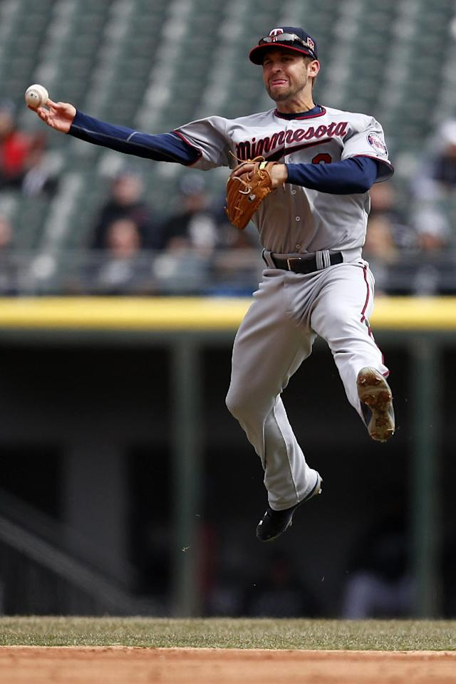 Minnesota Twins second baseman Brian Dozier is late on the throw as Chicago White Sox Avisail Garcia reaches first base during the second inning of a baseball game on Wednesday, April 2, 2014, in Chicago, Ill. (AP Photo/Andrew A. Nelles)