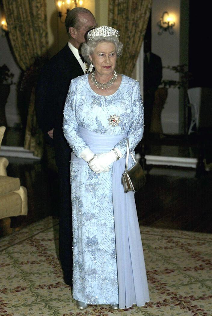 <p> Queen Elizabeth looked magnificent in a sparkling pale blue beaded dress, while visiting Jamaica in 2002. The dress was designed by Stewart Parvin and she paired it with a tiara, of course. </p>