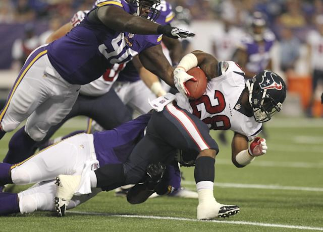 gMinnesota Vikings defensive tackle Fred Evans, left, comes looming in over Houston Texans running back Dennis Johnson (28) before brining him down in the first half of an NFL preseason football game, Friday, Aug. 9, 2013, in Minneapolis. (AP Photo/Genevieve Ross)