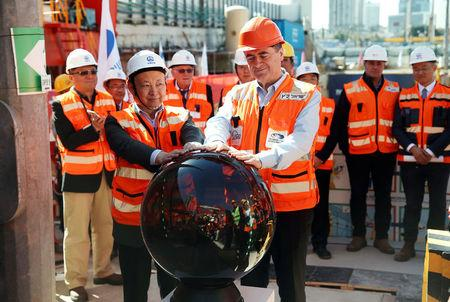 Yisrael Katz (front), Israel's Minister of Transport, and employees of China Railway Engineering Corporation, take part in an event marking the beginning of underground construction work of the light rail, using a Tunnel Boring Machine (TBM), in Tel Aviv, Israel February 19, 2017. Picture taken February 19, 2017. REUTERS/Baz Ratner