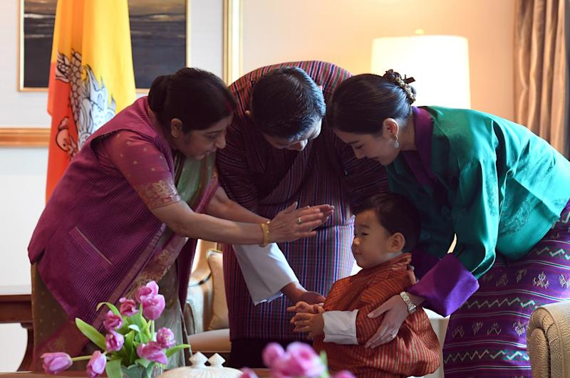 Indian foreign minister Sushma Swaraj, Bhutan's prince Jigme Namgyel Wangchuck, Bhutan's King Jigme Khesar Namgyel Wangchuck and Queen Jetsun Pema in New Delhi. (PRAKASH SINGH via Getty Images)