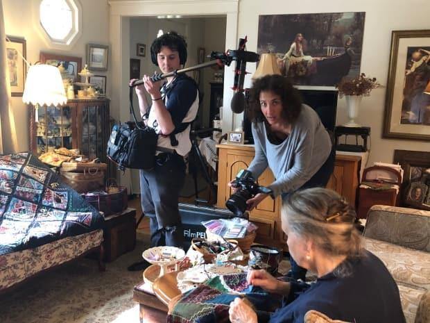 Sound recordist Curtis McNevin, left, and videographer Mille Clarkes, right, shoot a scene with quilter Penelope Player for the TV1 series Threading the Needle by Louise Lalonde Productions.