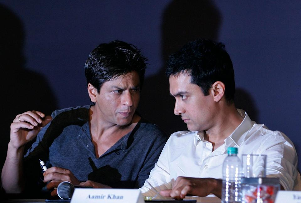 In this April 7, 2009, file photo, Bollywood actors Shah Rukh Khan, left, and Aamir Khan speak during a press conference in Mumbai (Copyright 2020 The Associated Press. All rights reserved.)