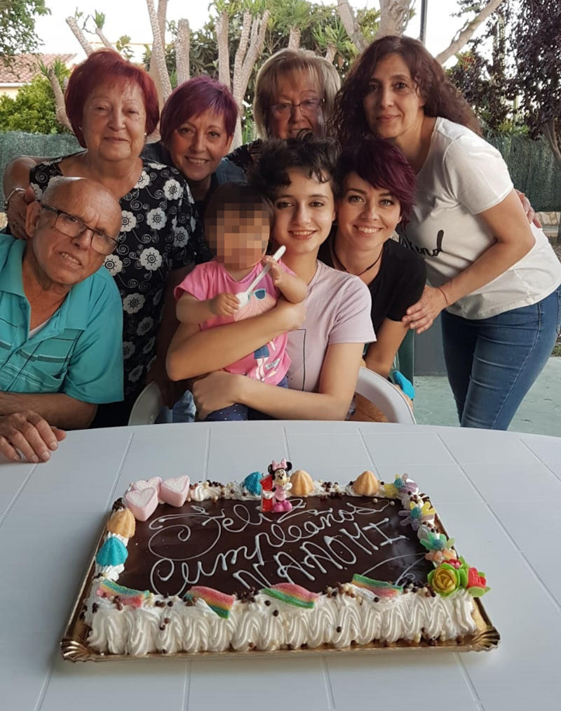 Patricia and her family crowd around a birthday cake for her daughter after she left the cult. Source: Real Press/Australscope